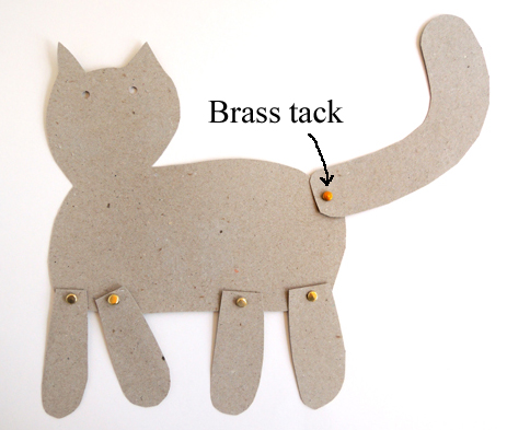 cat with brass tacks