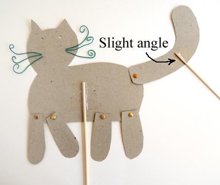 cat with sticks