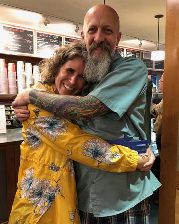 small world coffee hug