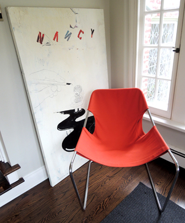orange chair and original art
